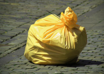 Yellow plastic bin liner packet