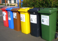 Recycling bins lined up on street