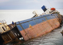 Old sunken ship exposed from marine water