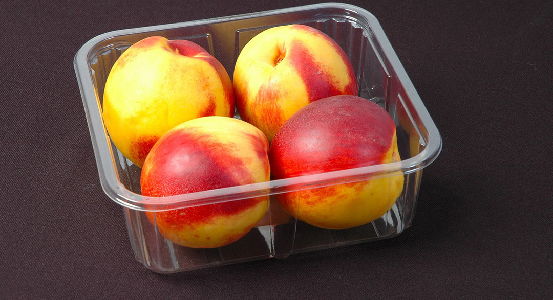 Nectarines in plastic punnet packaging