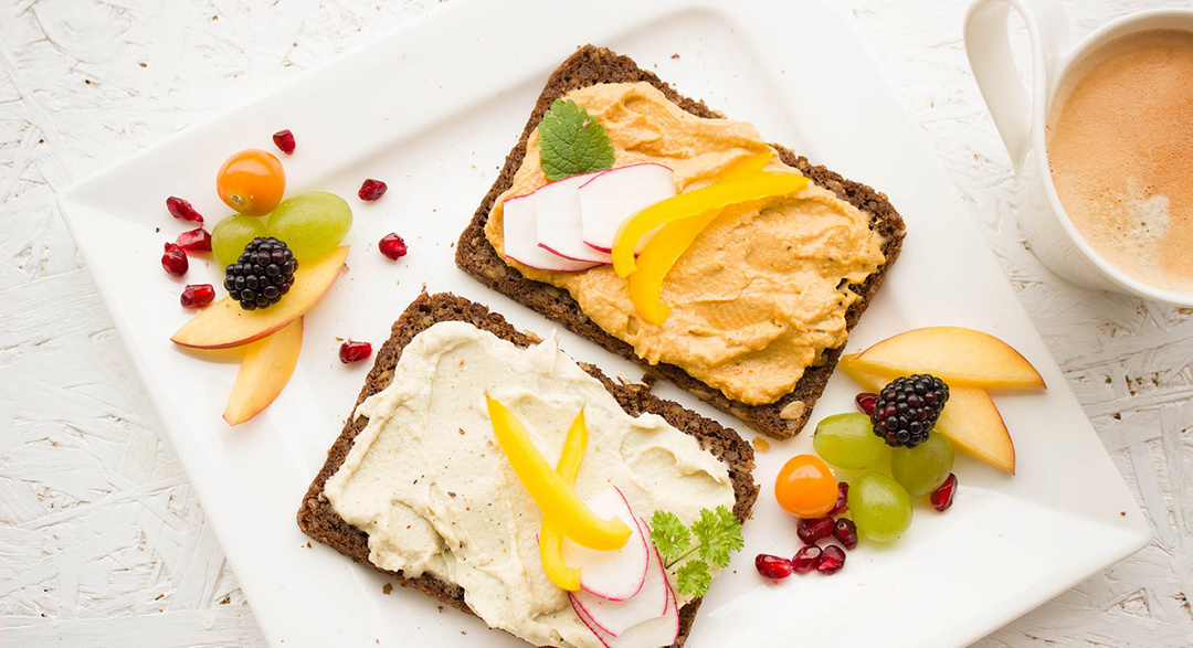 Health bread toast with hummus and fruits