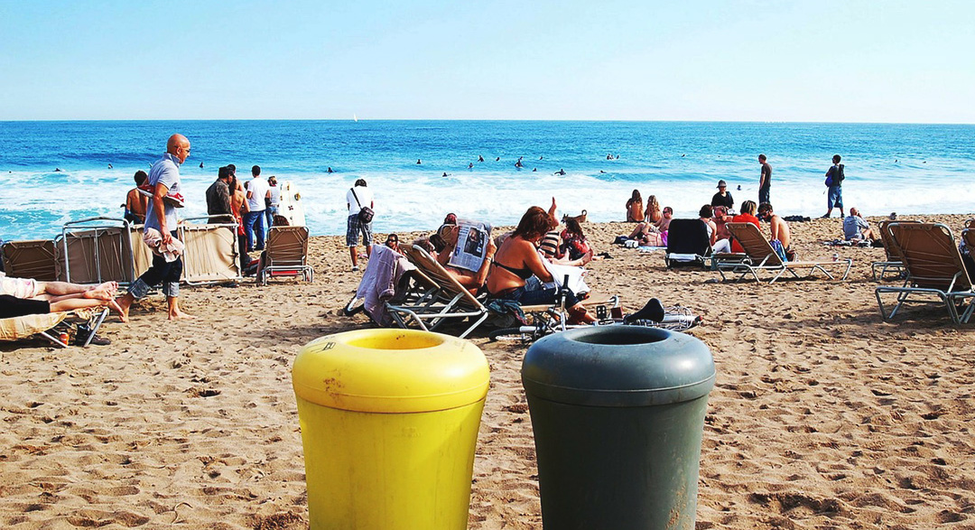Ocean pollution bins on beach