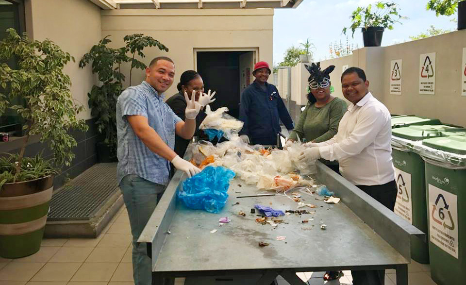 Hotel workers sorting waste