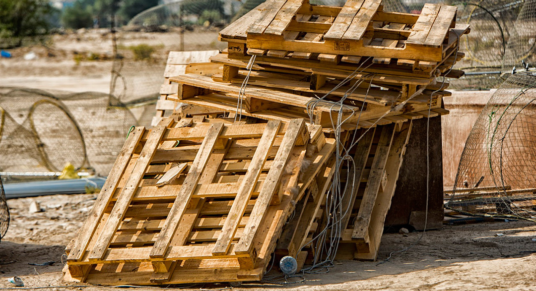Wooden pallets in junkyard