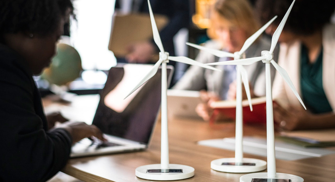 Renewable energy wind turbine models on desk