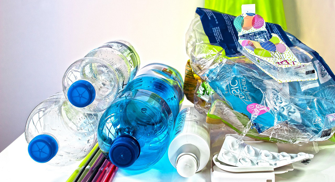 Plastic waste bottles, straws, packets and wrappers