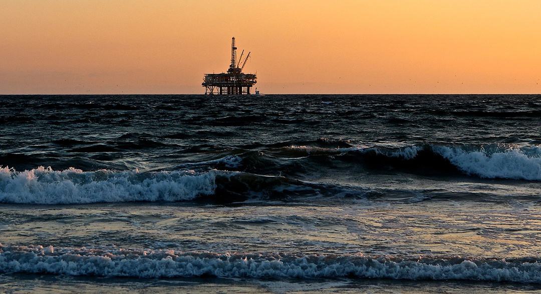 Gas rig off coastal beach