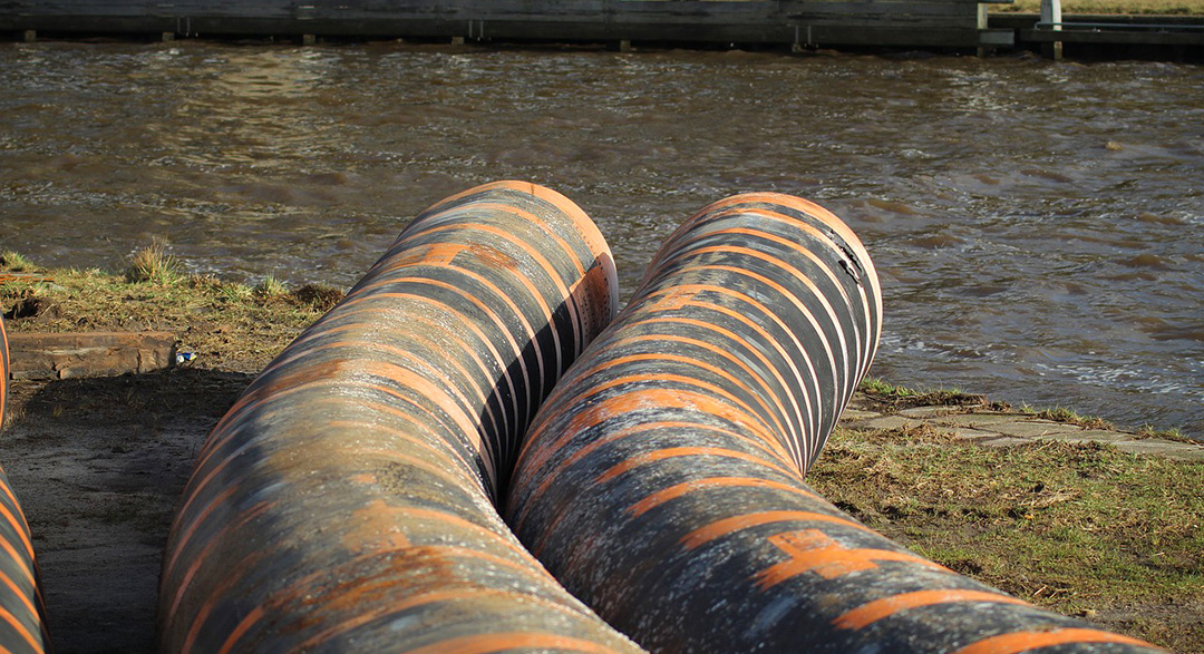 Sewage pipes feeding into river