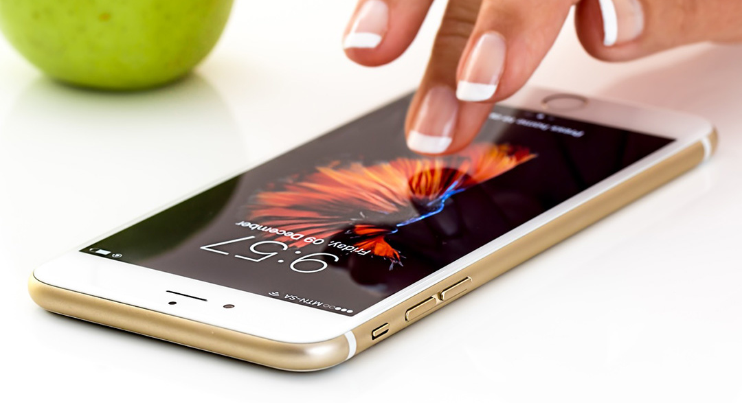 Smartphone on table will app on screen