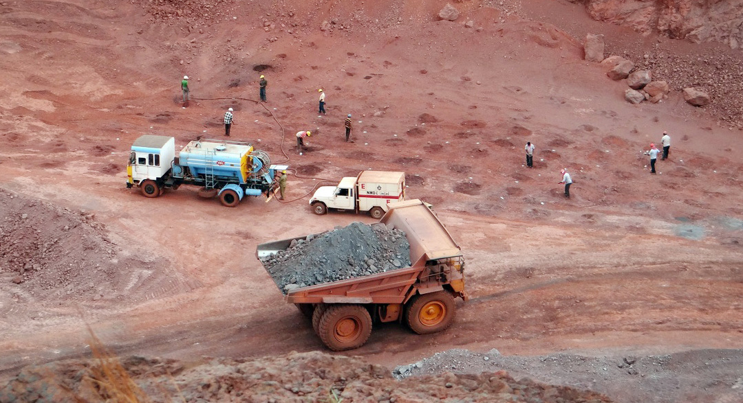 Mining dumptruck and workers on the ground