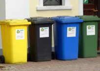 Recycling bins outside a building