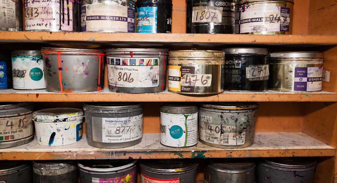 Liquid paint containers on a shelf